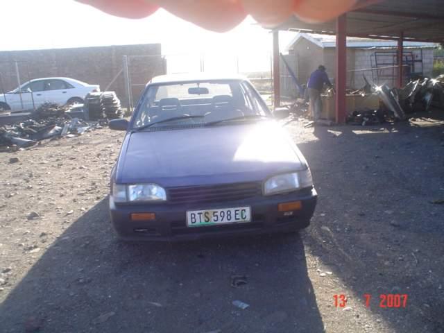 1998 MAZDA 323 1.3 L SEDAN
